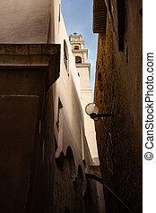 Old street of Jaffa in Tel-Aviv, Israel. View on St. Peter's Catholic Church.
