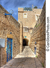 Vertical oriented image of old street and old houses in Jaffa, Israel.
