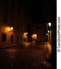 Old street with lamps at night