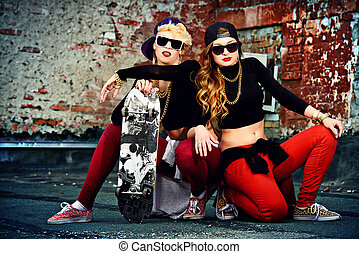 old streets - Modern hip-hop dancers over brick wall. Urban...