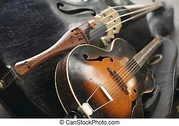 Old stringed musical instruments on cases.
