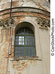 Old strucco molding window on the facade of the building in Lvov