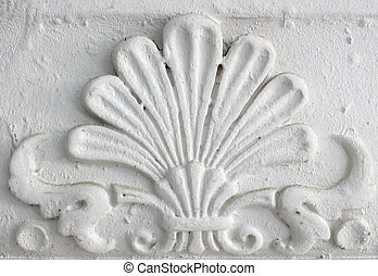 Old stucco molding. Vintage decorative element on white wall texture.