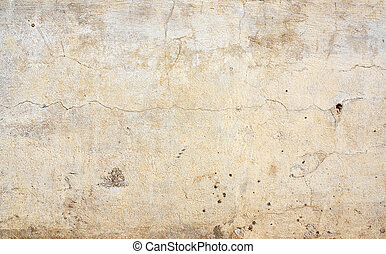 Old stucco wall texture of beige color