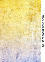 Old stucco wall texture of yellow and blue colors