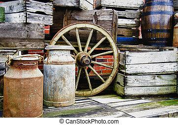 Arrangement of old stuff - Metal milk barrel, wooden boxes, fruit cases and other old stuff - Vintage
