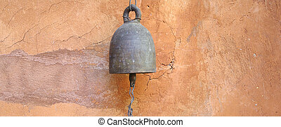old style bell on the wall