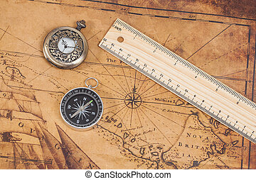 Old style brass compass on antique map