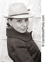 Old style duotone image with young woman in coat and hat