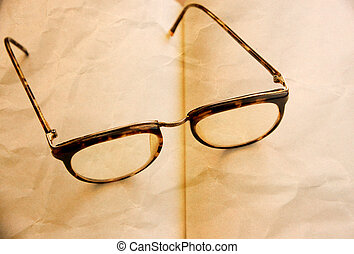 old style eyeglasses on the vintage paper