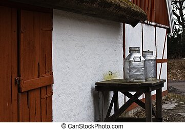 Old-style farm with milk cans