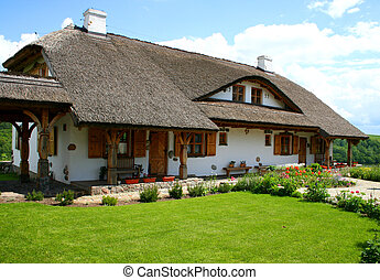 Modern house built in a traditional style. Countryside.