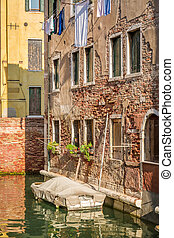 Old style house on a canal in Venice