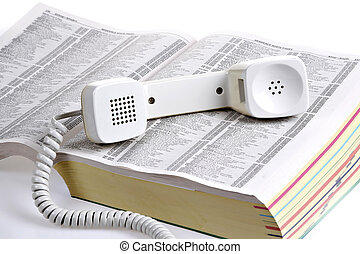 old style phone over yellow book - old style phone over...