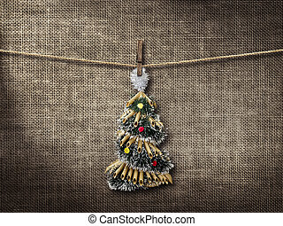 Old style photo  and Christmas tree hanging on a clothesline