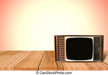 Old Style Photo. Classic vintage and retro TV on the table with wall background