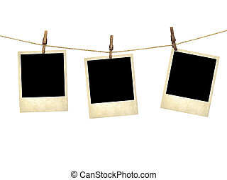 Old style photographs hanging on a clothesline isolated on ...