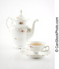 Old-style retro jug with tea on white background