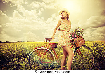 old style - Romantic young woman stands in a field with her ...