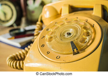 Old-style rotary phone numbers.