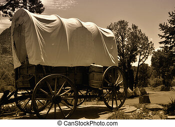 covered wagon - old style western covered wagon of the wild...