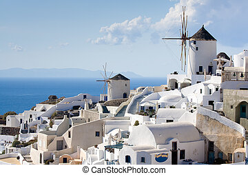 Old-style white traditional windmills in terraced village...