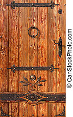 Old style wooden door with metal antique elements