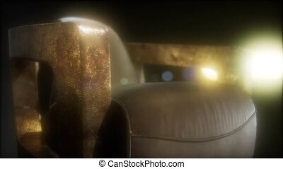 Old styled brown vintage armchair in the dark