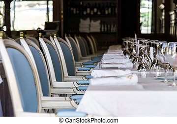Old-styled restaurant waiting for visitors. Served tables.