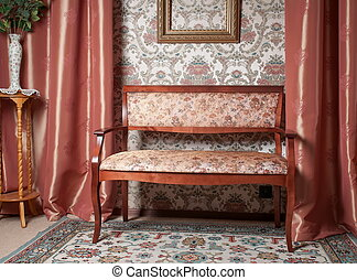 Old stylish brown couch in an antique house