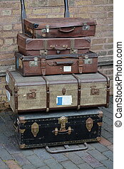 Old suit case and luggage at the train station