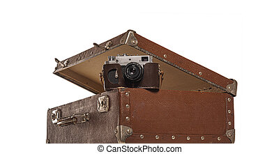 Old suitcase and old camera on white background.
