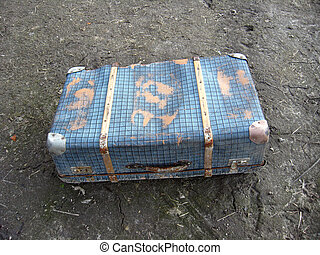 Old suitcase on the ground