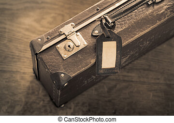 Old Suitcase - Sepia toned color photo of an old worn...