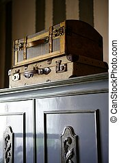 Old suitcases over the wardrobe, vintage style