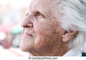 old sun stained wrinkled skin - profile portrait of a...