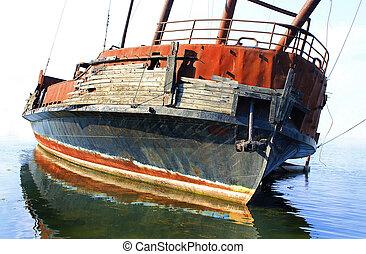 Old sunken ship on shore ground of lake Ontario