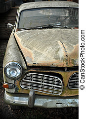 Old Swedish Car - Vintage abandoned Volvo Amazon on junkyard