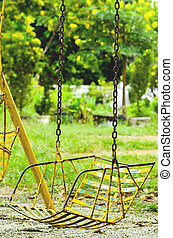 Old swings on playground