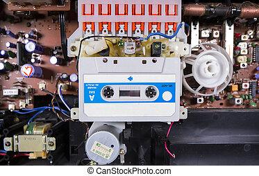 old tape cassette inside a broken hifi system