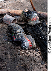 old tattered black sneakers