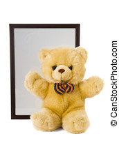 Old Teddy bear and empty photo frame