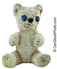 Old teddy bear; faded, worn, repaired, but still loved
