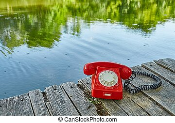 Old telephone in nature