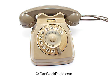 Old telephone isolated on white
