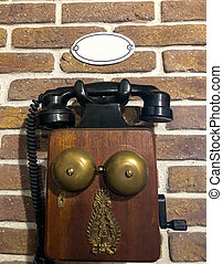 old telephone on the wall