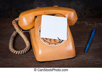 Old telephone on wood table. Still life