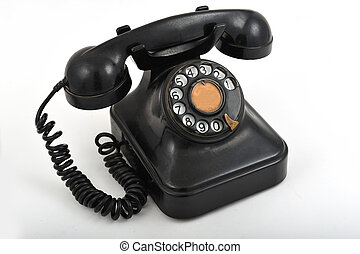 Old telephone - Black old style telephone on white...