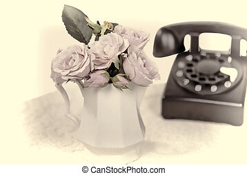 old telephone with roses