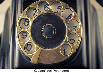 old telephone with rotary dial